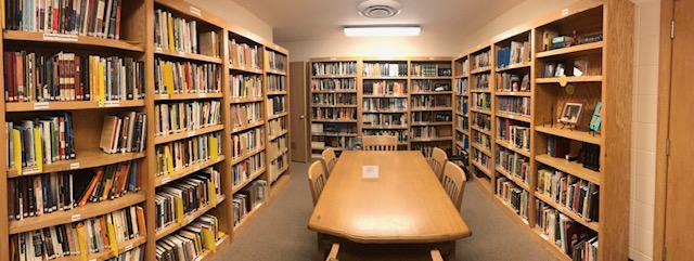 Library shelves around a table